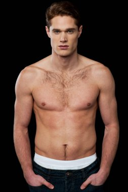 Shirtless young masculine man