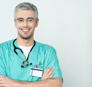 Smiling middle aged physician