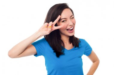 Excited girl doing victory sign on eye
