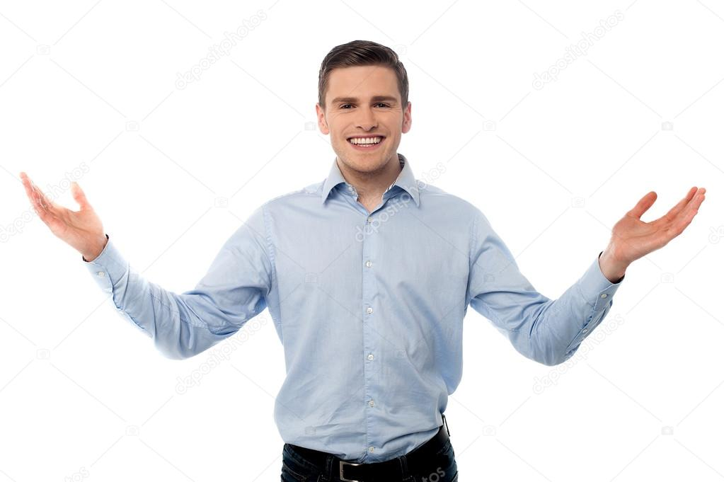 Happy young man with arms wide