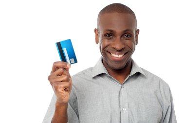 Man showing his debit card