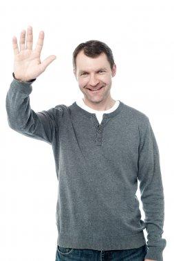 Man waving his hand
