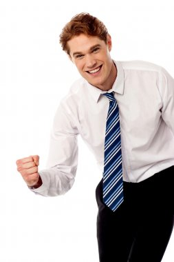 Enthusiastic corporate man clenching fist