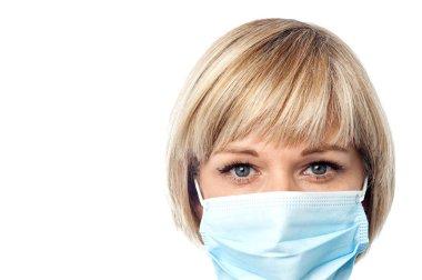 Female physician wearing medical mask