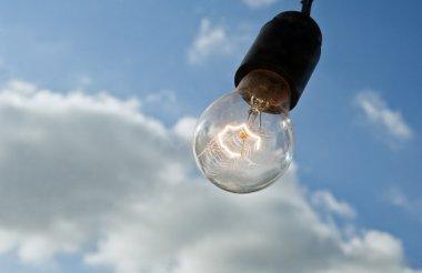 lightbulb on sky background