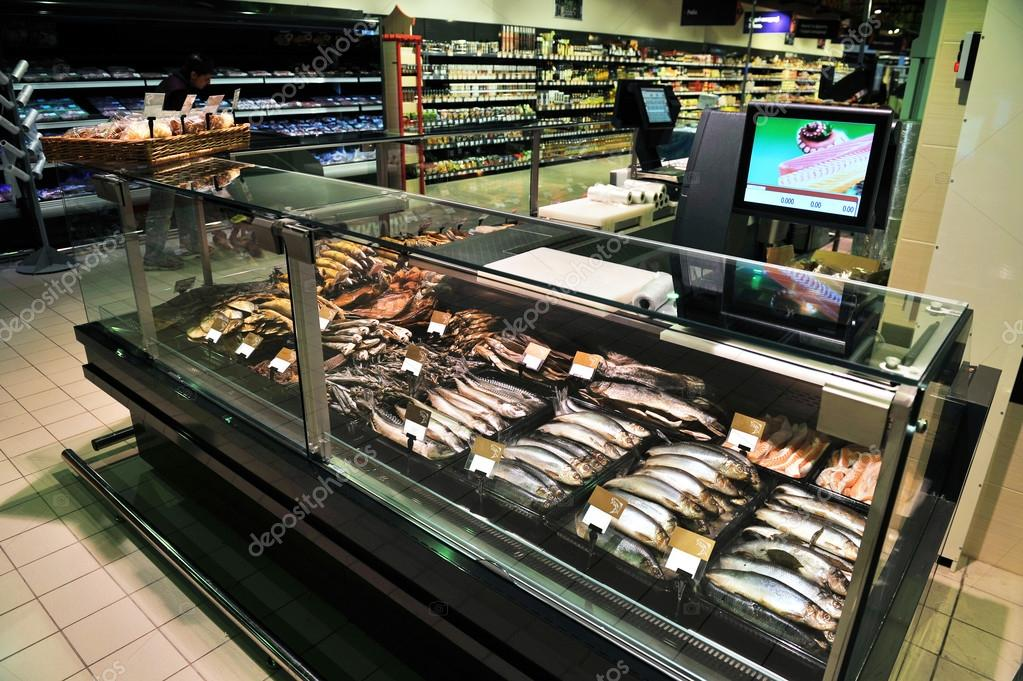 Fully loaded shelves with fish in a large supermarket