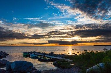 Peaceful sea sunset and boats