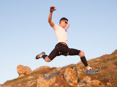 Man practicing trail running and leaping