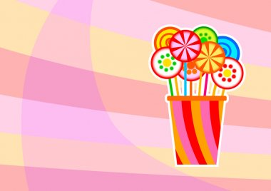 Colorful lollipops on abstract background