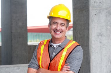 Portrait of a happy construction worker shot outside stock vector