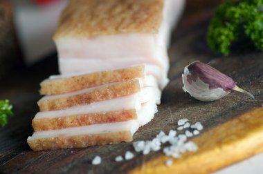 Sliced pork salted lard close up