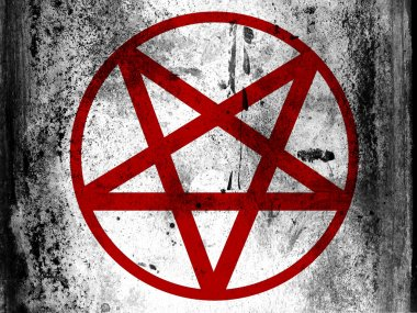 Pentagram symbol painted on board with grungy dirty stains all over it