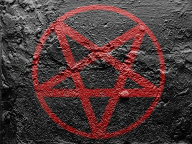 Pentagram symbol painted on grunge wall