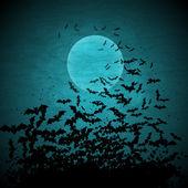 Fotografia sfondo vettoriale di Halloween con Luna e pipistrelli