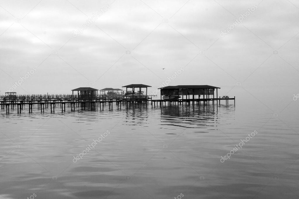 Fog covered dock on the St Johns River in Jacksonville Florida