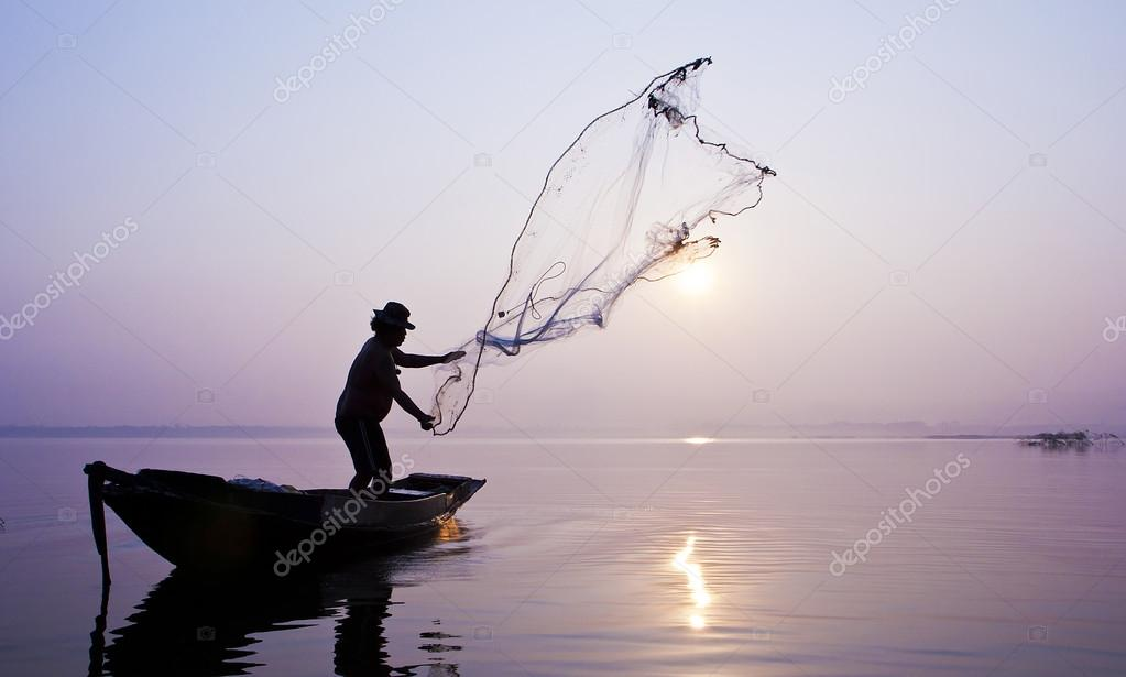 Fishermen are catching fish with a cast net.