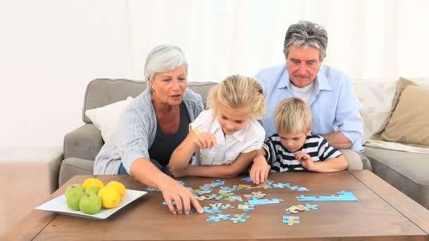 Family doing a puzzle — Stock Video © Wavebreakmedia #15536649