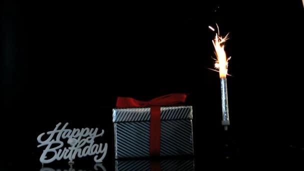Sparkler Burning Beside Gift And Happy Birthday Sign Stock Video C Wavebreakmedia 25671141