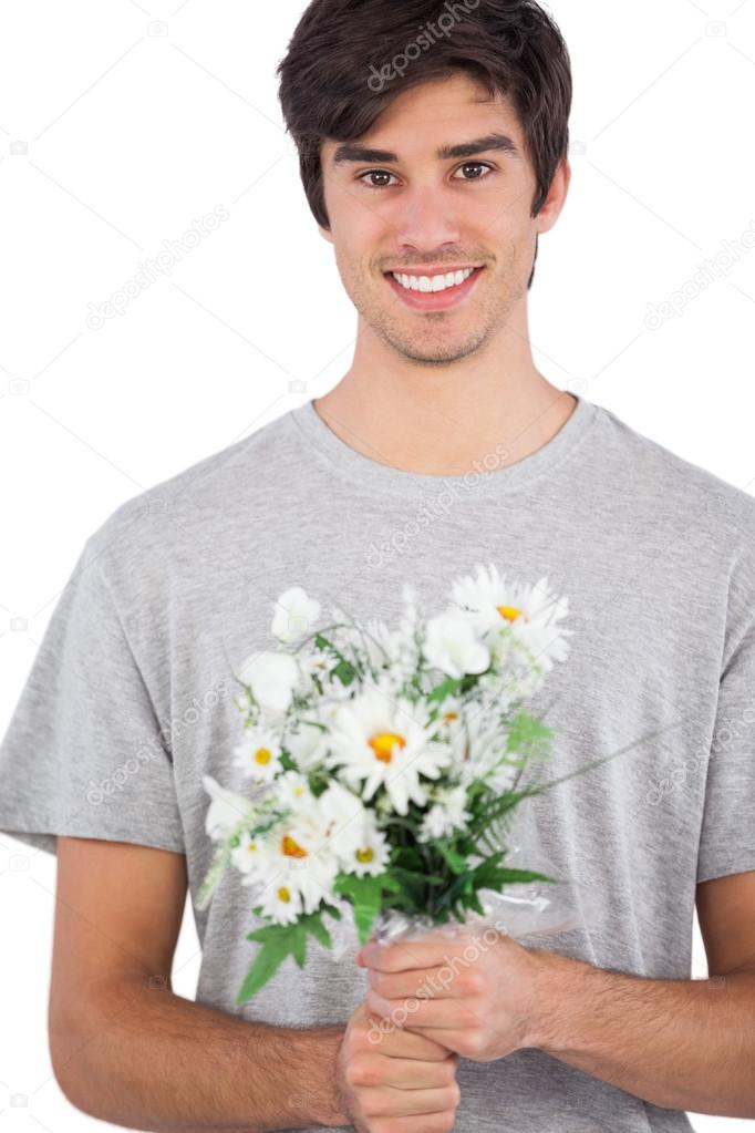 Young man holding flower bouquet — Stock Photo © Wavebreakmedia ...
