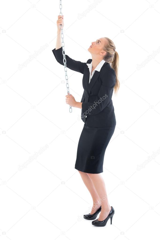 Pulling The Chain Unique Chic Businesswoman Pulling A Chain Stock Photo © Wavebreakmedia