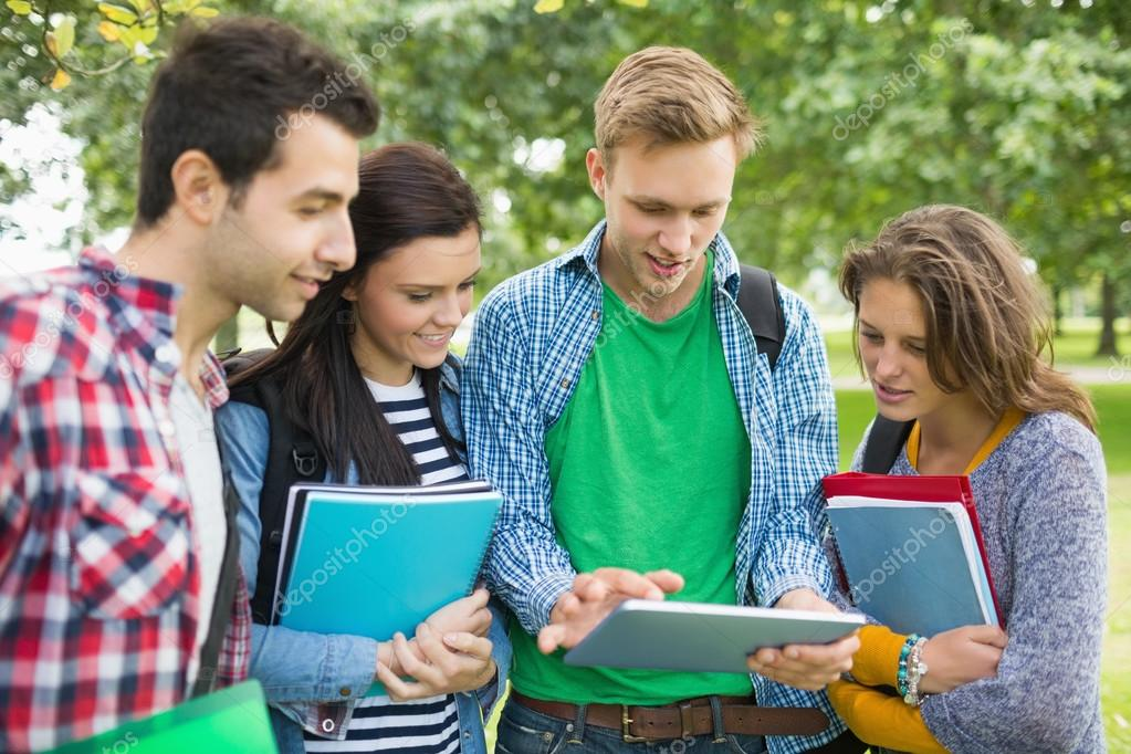 College Students With Bags And Books Using Tablet PC In Park Stock Photo 36185403