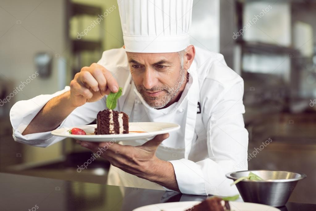 Concentrated Male Pastry Chef Decorating Dessert In Kitchen Stock Photo Image By C Wavebreakmedia 42922053