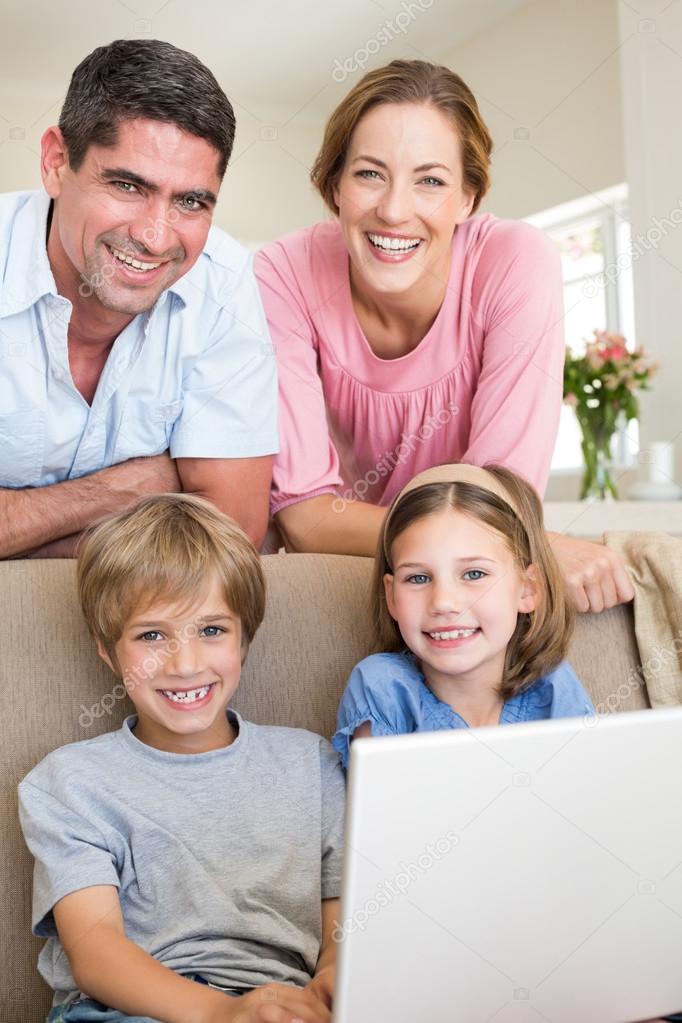Family with laptop in living room — Stock Photo © Wavebreakmedia ...