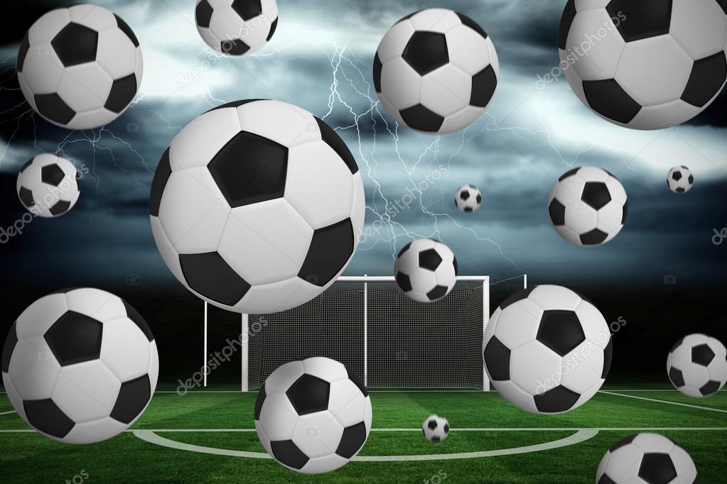 Білі та футбольні м ячі проти футбольне поле під бурхливому небі — Фото від  Wavebreakmedia. Знайти схожі зображення f1532cdd1dd7f