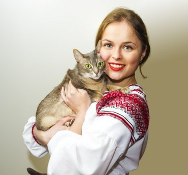 Portrait of beautiful young woman in the Ukrainian national clot