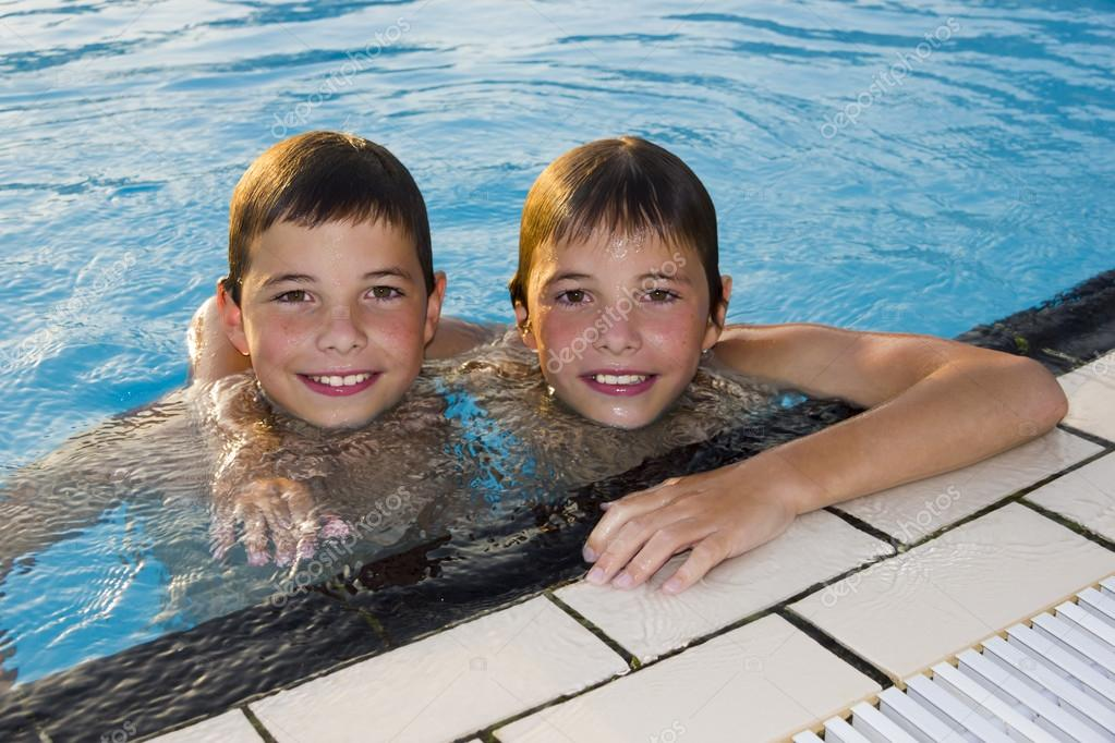 Activities On The Pool Cute Boys Swimming And Playing In Water Stock Photo Tetyanka 26014507