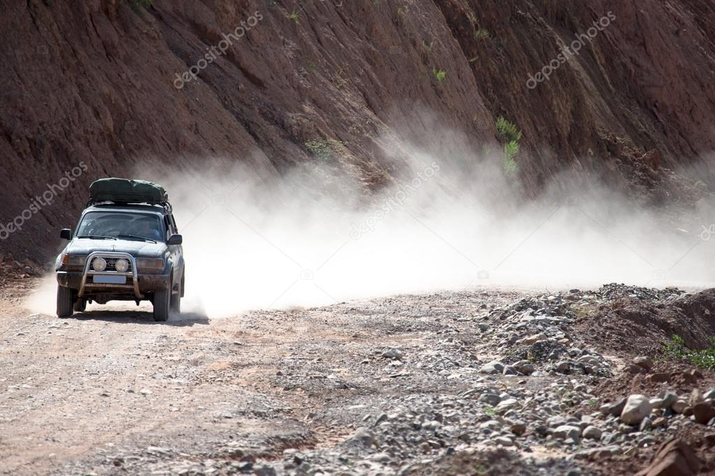 SUV on a mountain dirt road