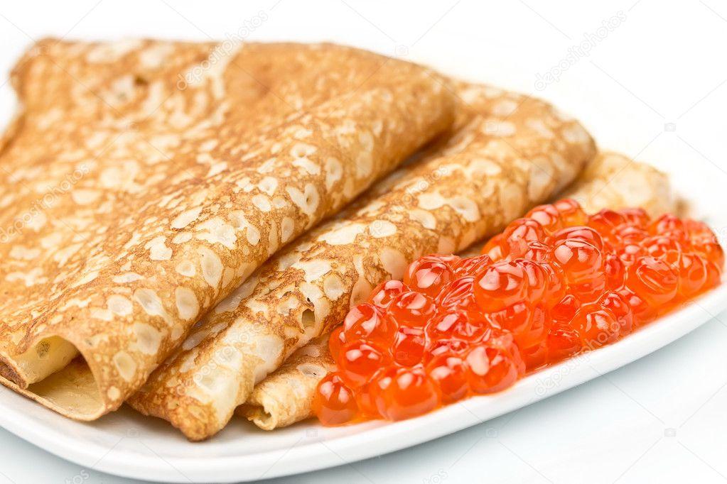 Thin pancakes with salmon caviar