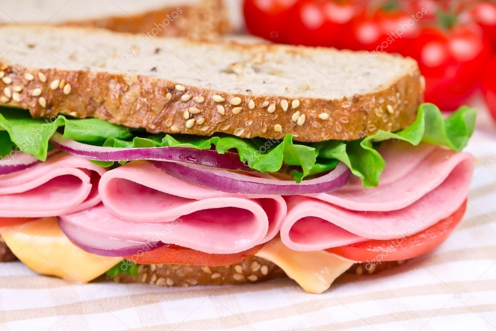 sandwiches with ham, cheese and tomato