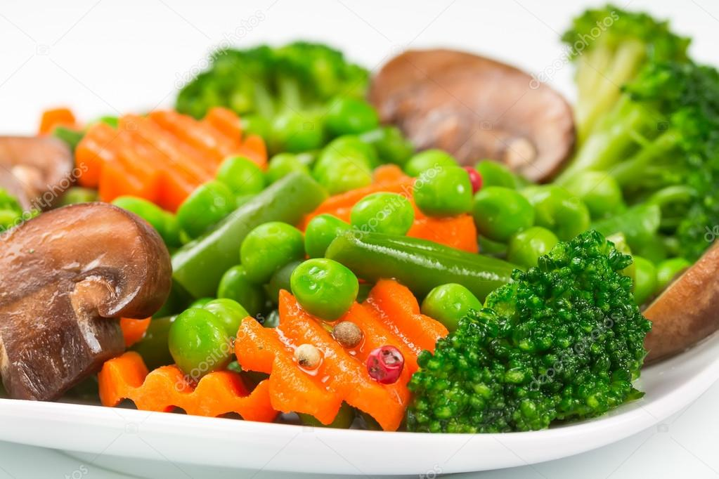 Steamed vegetables on a white plate