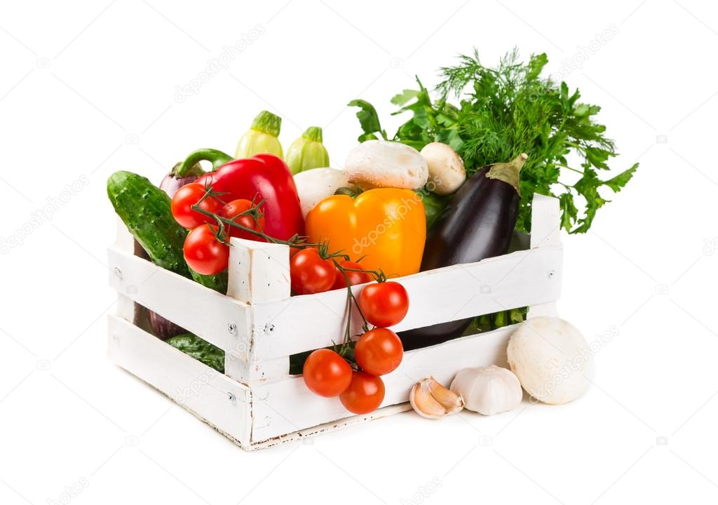 Fresh vegetables in a painted wooden box