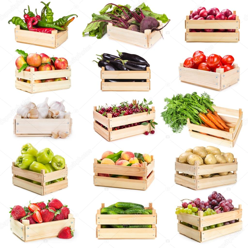 Set of wooden boxes with vegetables, fruits and berries