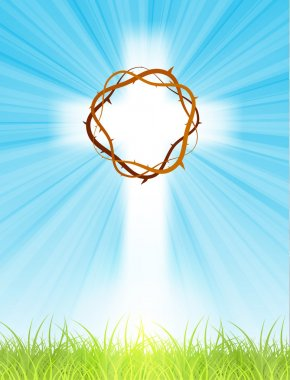 cross on blue sky, with sun rays and green lawn