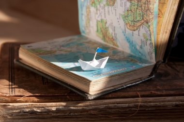 Sailing boat and map.