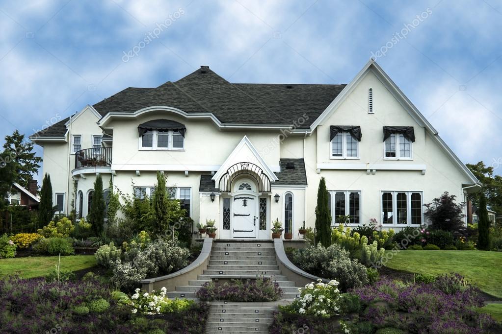 Exterior of white stucco luxury house