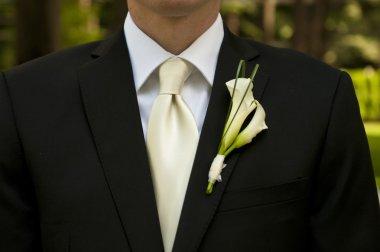 Wedding groom with corsage