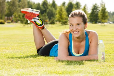 Happy woman jogger training in the park. Healthy lifestyle and p