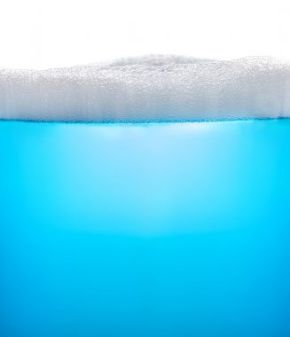 Blue water with foam or soap