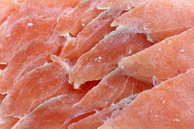 Frozen sliced raw salmon