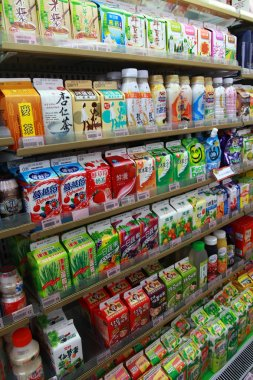 Vegetable juice, Fruit juice and Milk on the shelves in a supermarket