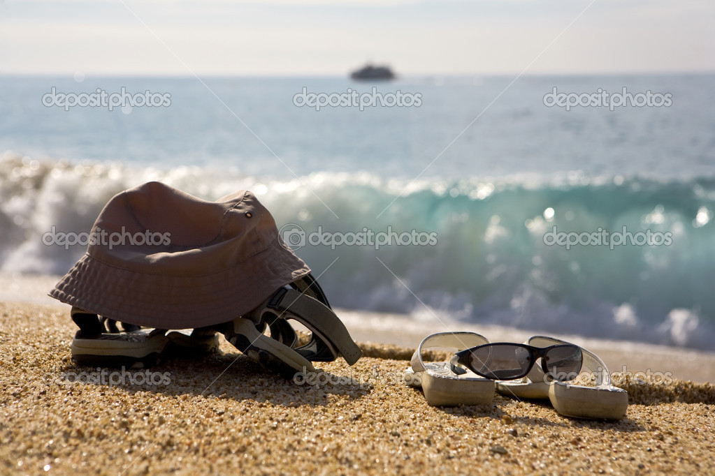 279a2250b A photo of two pairs of beach shoes at the seaside — Photo by eagle13