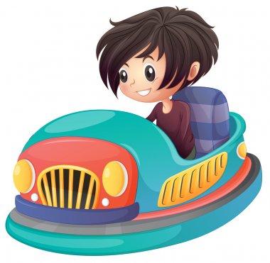 A boy driving bumper car