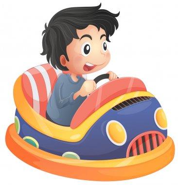 A child riding in a bumpcar