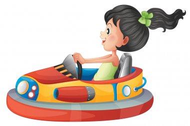A girl driving the bumpercar