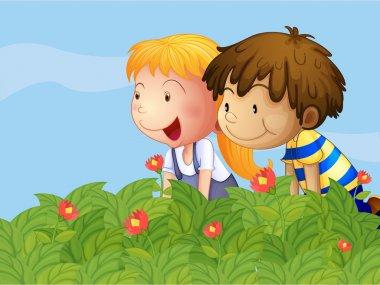 A boy and a girl in the garden