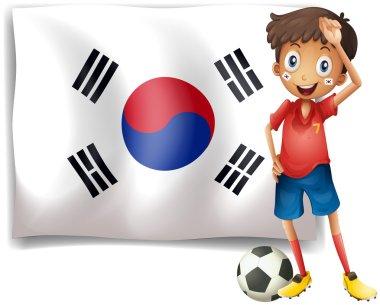 A soccer player beside a Korean flag
